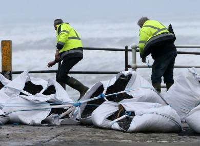 Workers battling the elements to get storm defences in place at Lahinch, Co Clare earlier this month.
