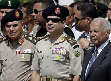 Egypt Defence Minister Gen Abdel-Fattah el-Sissi (centre), Egyptian Prime Minister Hazem el-Beblawi (right), and army Chief of Staff Lt. Gen. Sedki Sobhi (left).