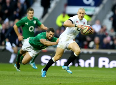 Mike Brown tackled by Rob Kearney.