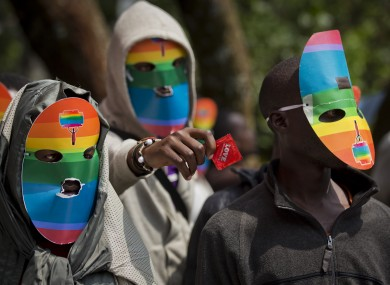 Kenyan gays and lesbians and others supporting their cause wear masks to preserve their anonymity in a protest against the Ugandan laws.
