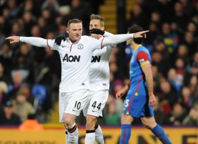 Manchester United's Wayne Rooney celebrates scoring t
