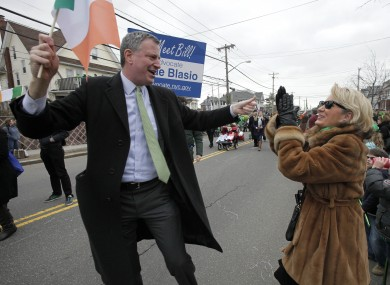 De Blasio taking part in the Queens County St. Patrick's Day Parade in the Rockaway section of New York last year.