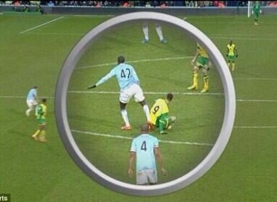 Toure appears to kick out at Van Wolfswinkel.