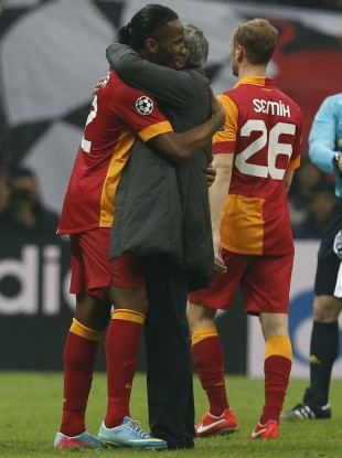 Drogba and Mourinho hug after Real Madrid and Galatasaray met in the competition last year.