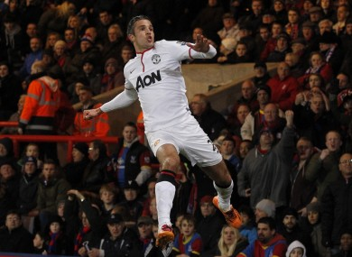 Van Persie celebrates his goal against Crystal Palace.