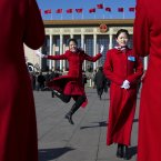 Chinese hostesses, who serve the delegates of the Chinese People's Political Consultative Conference and National People's Congress, have souvenir photos taken in front of the Great Hall of the People in Beijing.<span class=