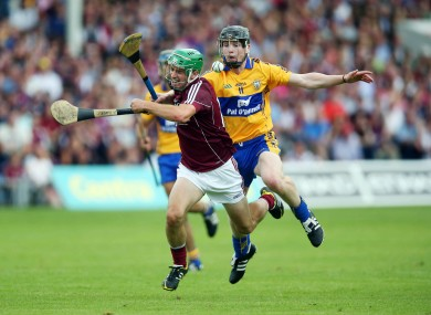 Galway's David Burke and Clare's Tony Kelly.