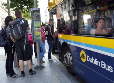 Passengers getting on the bus at O'Connell Street.