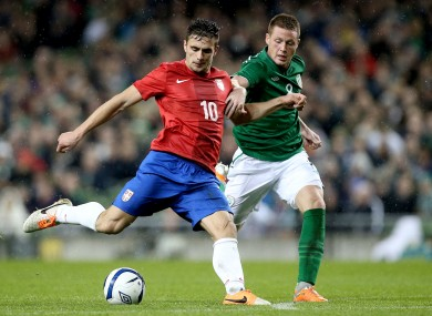Ireland's James McCarthy and Dusan Tadic of Serbia.