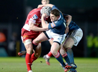 Jonathan Davies is tackled by Ian Keatley.