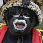 Members of the Krewe of Zulu march during Mardi Gras day in New Orleans.<span class=