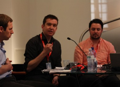 Mark Little (centre) speaking at a journalism conference