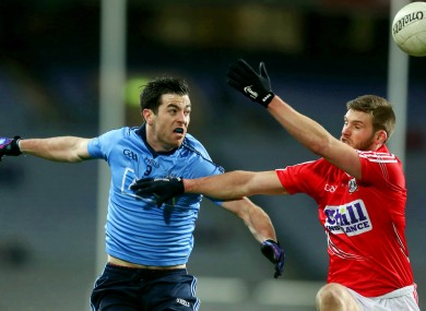 Dublin's Michael Dara Macauley and Cork's Eoin Cadogan.