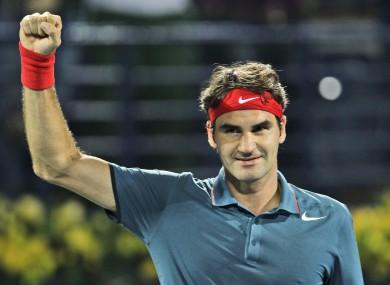 Roger Federer celebrates after he beat Novak Djokovic.