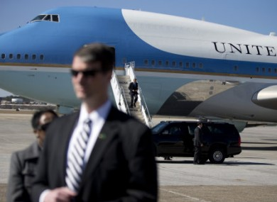 A Secret Service stands guard as President Barack Obama lands in Air Force One.