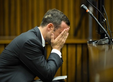 Oscar Pistorius cradles his head in his hands in court on the fifth day of his trial at the high court in Pretoria.