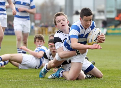 Blackrock's Patrick Patterson goes over for a try despite the effort of Ruadhan Byron of Belvedere.