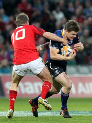 Ronan O'Gara and Brian O'Driscoll clash in 2012.