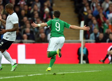 Shane Long celebrates his goal against England.