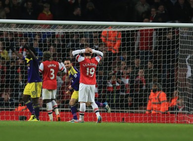 Swansea City's Leon Britton (3rd left) celebrates the equaliser own goal scored by Arsenal's Mathieu Flamini (right).