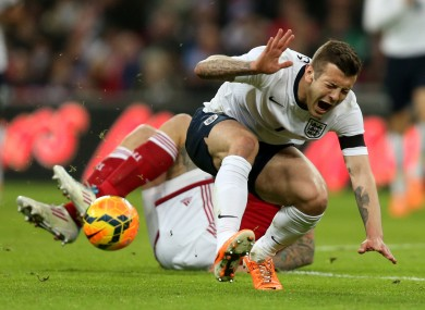 Jack Wilshere is challenged by Denmark's Daniel Agger last night.