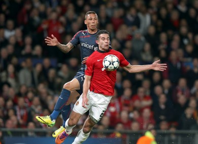 Robin van Persie is fouled ahead of United's first goal.