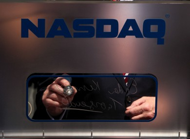 Enda Kenny signs his autograph after ringing the NASDAQ opening bell for the first time in Ireland last year.