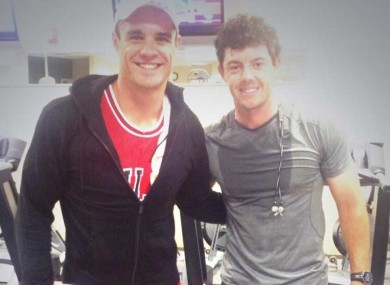 All Blacks star Dan Carter and Rory McIlroy in Augusta yesterday.
