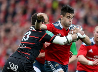 Murray bursts forward against the tackle of Florian Fritz at Thomond Park.