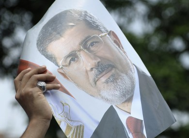 A protester hold a photograph of ousted president Mohammed Morsi