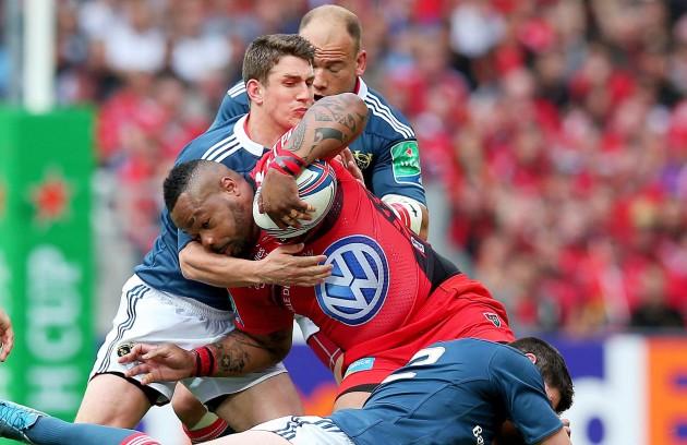 Ian Keatley, BJ Botha and James Downey tackle Mathieu Bastareaud