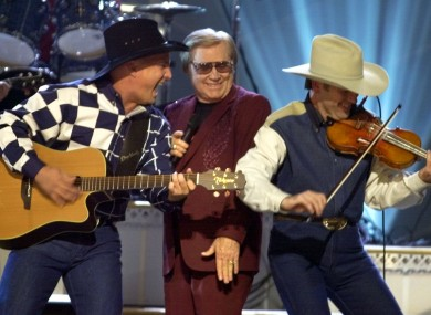 Garth Brooks, left, and George Jones perform on stage in 2001