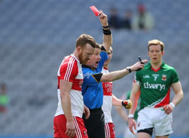 Padraig Hughes issues a red card to Fergal Doherty.
