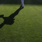 Philadelphia Phillies' Ryan Howard casts a shadow as he throws the ball during practice for a baseball game against the Los Angeles Dodgers in Los Angeles. (AP Photo/Jae C. Hong)<span class=