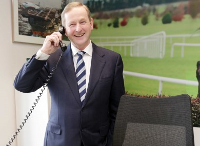 The Taoiseach takes a call at the new Ryanair office in Dublin on Thursday.