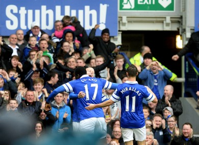 Lukaku and Naismith celebrate for Everton.
