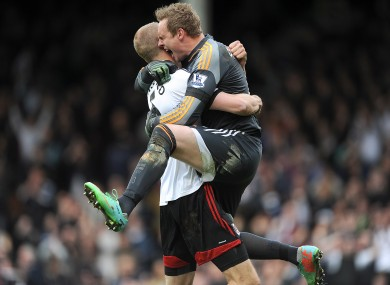 Fulham's Brede Hangeland and team-mate David Stockdale celebrate wildly after the final whistle.