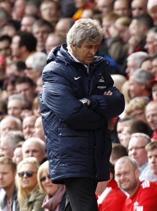 Manchester City manager Manuel Pellegrini looks dejected on the touchline.
