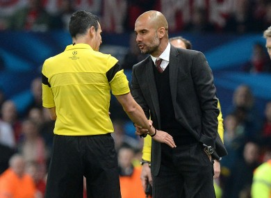Bayern Munich's Pep Guardiola argues with referee Carlos Velasco Carballo after he gave a red card to Bastian Schweinsteiger.