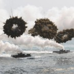 South Korean marine LVT-7 landing craft sail to shores through smoke screens during the US-South Korea joint military exercises called Ssangyong, part of the Foal Eagle military exercises, in Pohang, South Korea.<span class=
