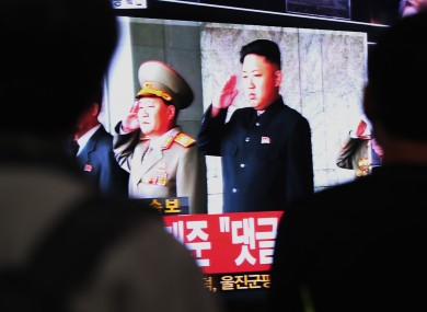 South Koreans watch a television broadcasting a video image of North Korean leader Kim Jong Un