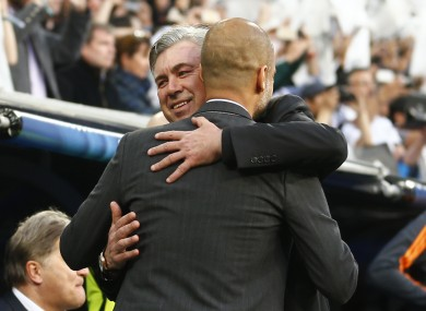 Real's coach Carlo Ancelotti hugs Bayern head coach Pep Guardiola tonight.