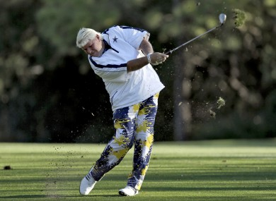 John Daly not hitting a golf ball out of a woman's mouth.