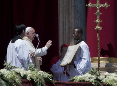 Pope Francis delivers his blessing at the end of the Urbi et Orbi (Latin for to the city and to the world) blessing from the balcony of St. Peter's Basilica.