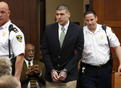Hernandez is led into the courtroom yesterday.