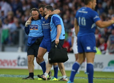 Kearney is helped off the RDS pitch last Saturday.