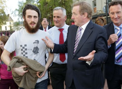 Enda Kenny talks to Jack O'Donnell from Dundalk (left) during a canvass in the town this week.