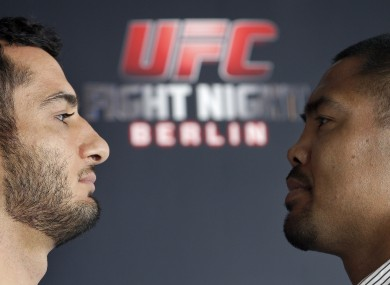 Dutch middleweight fighter Gegard Mousasi, left, and Mark Munoz from the US.