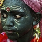 An Indian boy with his face painted participates in a procession on the occasion of Chandan Yatra festival in Puri, India. <span class=