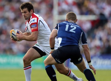 Payne looks for a route around Madigan in the Pro12 final last year.